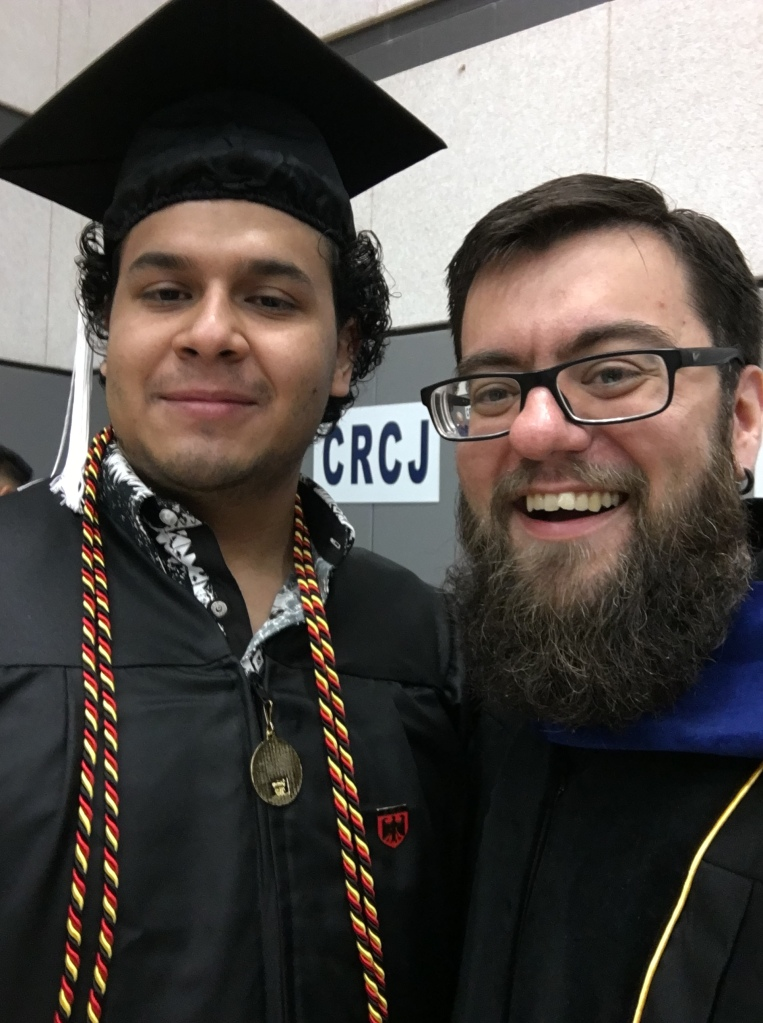 Dr. Ponce with a student at graduation